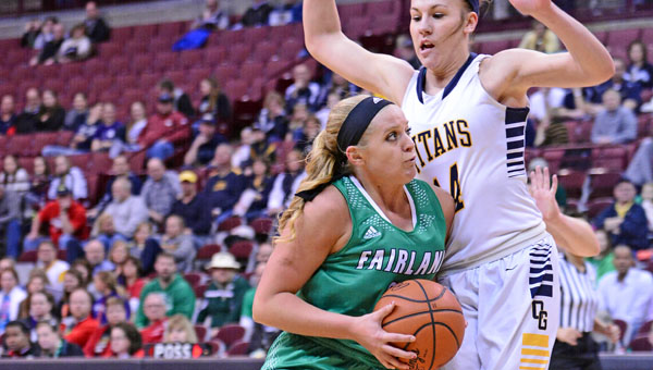 Fairland Lady Dragons' Kelsey Riley (left) derives past Ottawa-Glandorf's Elissa Ellerbrock (right) during Thursday's Division III state semifinal game in the Schottenstein Center.  Fairland fell to O-G 55-27. (Kent Sanborn of Southern Ohio Sports Photos)