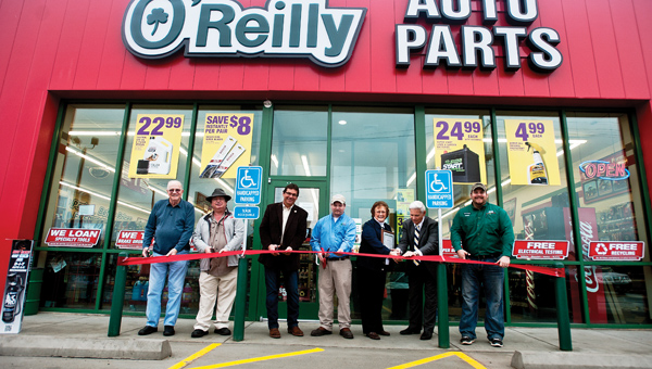 THE TRIBUNE/JESSICA ST JAMES Members of the community welcome O'Reilly Auto Parts on Wednesday morning. Pictured left to right, South Point Mayor Ron West, Lawrence County Treasurer Stephen Dale Burcham, Fayette Trustee Perry Brock, manager J.R. Fields, Shirley Dyer and Bill Dingus, with the Lawrence County Chamber of Commerce and assistant manager Jacob Wells.