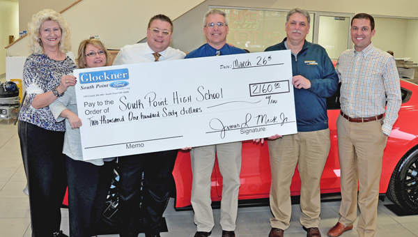 Glockner Ford of South Point made a donation of $2,160 to the South Point High School athletic department. Pictured from left to right are: Glockner Ford employees Marji Thomas and Debbie Ramey, general manager J.L. Mick, South Point principal Ben Coleman, South Point athletic director Dave Adams, and dealership president Tim Glockner. (Kent Sanborn of Southern Ohio Sports Photos)