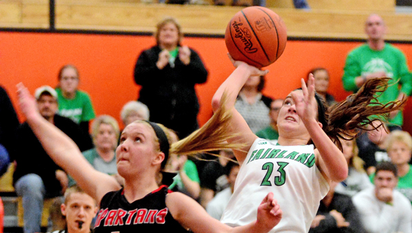 Fairland Lady Dragons' Caitlin Stone (23) shoots a jump shot over Alexander's Leah Richardson (4) after making a steal during Friday's Division III district championship game. Fairland beat Alexander 42-38 for its fourth straight district title. (Kent Sanborn of Southern Ohio Sports Photos)