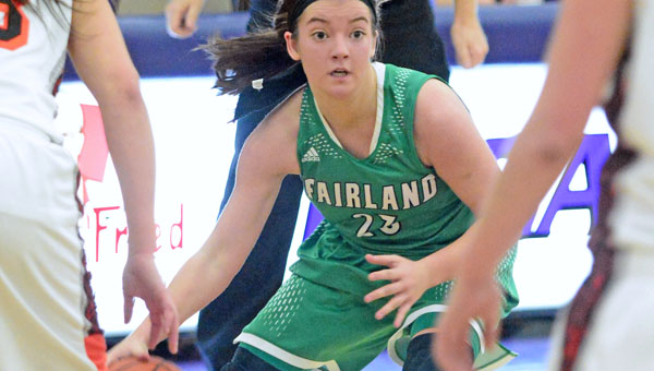 Fairland Lady Dragons' Caitlin Stone (23) looks for an open teammate as she brings the ball up the court. Fairand beat Wheelersburg 46-41 to reach the Division III regional finals. (Kent Sanborn of Southern Ohio Sports Photos)
