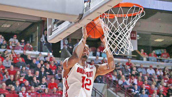 Ohio State Buckeyes' Sam Thompson (12) goes high in the air to slam home a dunk. The Buckeyes rallied to beat Purdue 65-61 on Sunday in a Big Ten game. (MCT Direct Photo)