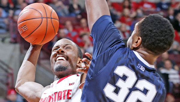 Ohio State's Sam Thompson (12) goes for a jam during a game against Penn State. The Buckeyes will play Virginia Commonwealth on Thursday in the NCAA Tournament. (MCT Direct Photos)
