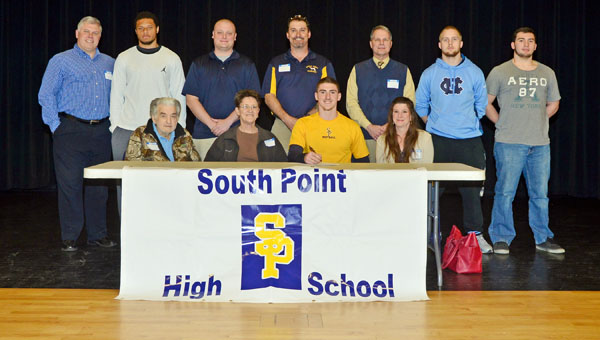 South Point Pointers' senior quarterback Gage Townson signed to play at Golden West Junior College in Huntington Beach, Calif., on Monday. Attending the signing ceremony were: seated from left to right, grandfather Ollie Warf, grandmother Linda Warf, Gage, and mother Donna Jarrell; standing from left to right, assistant coach Ryan Salmons, teammate Mason White, assistant coach Chris Napier, father Rob Townson, former head coach Rick Marcello, and teammates James Leonard and Tyler Nicely. (Kent Sanborn of Southern Ohio Sports Photos)