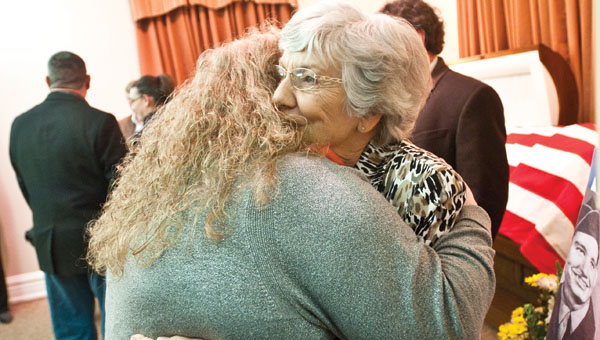 Phyllis Dornon is comforted by friends and family during her brother Earl Hilgenberg's memorial service on Friday. Hilgenberg died a prisoner of war during the Korean War. His remains were identified and returned to his family after more than 60 years.