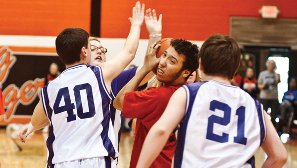A Cardinal from Vern Riffe finds himself surrounded during a basketball game against the Open Door School Jets Thursday at the Conley Center at Ironton High School.