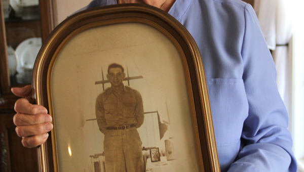 Courtesy of The Sentinel-Record/Beth Bright  Phyllis Dornan holds a photo of her brother, Sgt. 1st Class Earl Hilgenberg, who was reported missing in action by the United States Army on Nov. 2, 1950. In October, Dornan received a call that her brother's remains had been recovered.