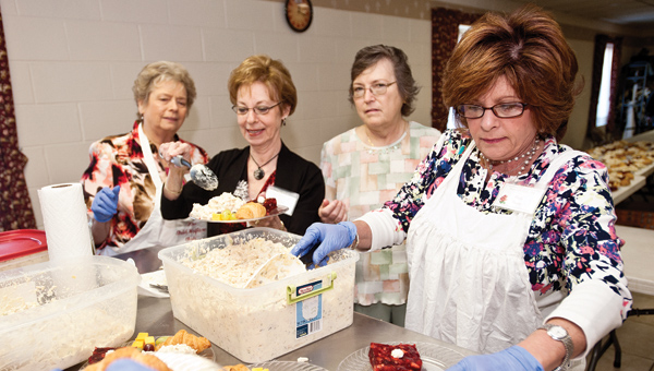 Women from the Lawrence County Child Welfare Club gather at the First Church of the Nazarene as they put on their 2014 spring luncheon fundraiser. Proceeds from the luncheon go toward projects such as Secret Santa, Tools 4 School, scholarships and much more. This year's luncheon will feature two separate days. A takeout only day on March 26 and an eat-in luncheon event on April 9.