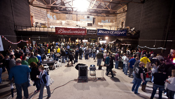 Beer enthusiasts gather inside the Ro-Na Theater on Saturday for the Great River Craft Brew Fest in downtown Ironton.