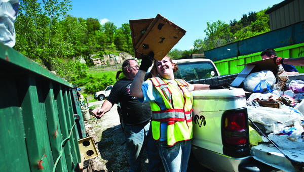 Volunteers from the Proctorville Fire Department unload unwanted items last year.