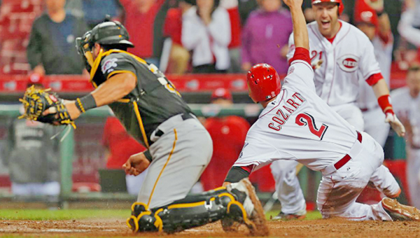 Cincinnati's Zack Cozart (2) slides safely across home plate with the winning run in the 11th inning following a two-out single by Joey Votto as the Reds beat the Pittsburgh Pirates 5-4 on Wednesday. (Courtesy of the Cincinnati Reds.com)