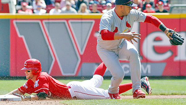 Cincinnati's Zack Cozart slides safely into second base with a fifth inning double during Saturday's game against the St. Louis Cardinals. Cozart had two hits but the Reds lost 4-1. (Courtesy of the Cincinnati Reds.com)