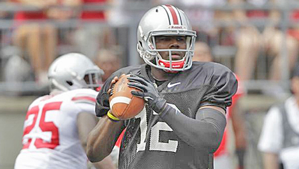 Ohio State quarterback Cardale Jones looks for an open receiver during Saturday's Scarlet-Gray spring game. Jones had two touchdown passes as the Gray won 17-14. (Courtesy of the Ohio State University)