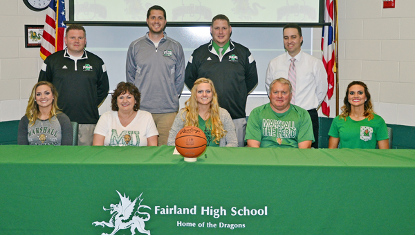 Fairland Lady Dragons' senior Kelsey Riley signed to play basketball at Marshall University. Attending the ceremony were: seated from left to right, sister Carley Riley, mother Barbara Riley, Kelsey, father Scott Riley and sister Kara Riley; standing from left to right, Fairland head coach Jon Buchanan, assistant coach Adam Alt, athletic director Jeff Gorby and principal Chad Belville. (Kent Sanborn of Southern Ohio Sports Photos)