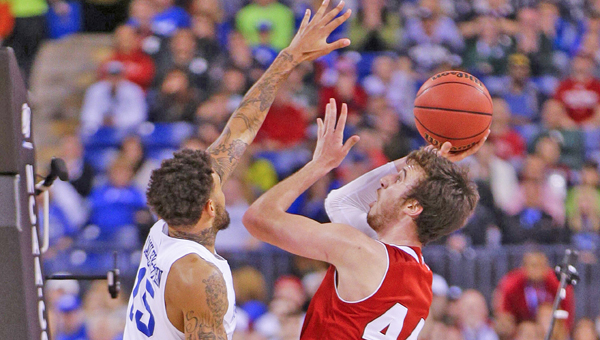 Wisconsin's Frank Kaminsky (44) scores over Kentucky's Willie Cauley-Stein (15) in the NCAA Tournament national semifinal at Lucas Oil Stadium in Indianapolis on Saturday, April 4, 2015. Wisconsin advanced, 71-64. (Mark Cornelison/Lexington Herald-Leader/TNS)