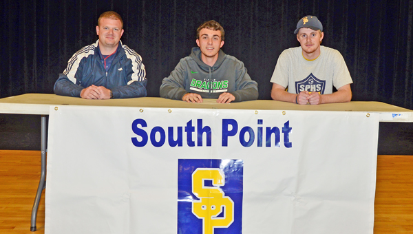 South Point Pointers' senior soccer player Trey Kearns signed a letter-of-intent to play at Tiffin University. Attending the signing were: seated from left to right, Pointers' head coach Zane Joy, Kearns and assistant coach Zack Jenkins. (Kent Sanborn of Southern Ohio Sports Photos)