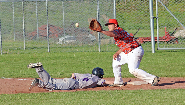 Chesapeake Panthers' Alex Miller (6) dives back into first base ahead of the throw to Ironton Fighting Tigers' first baseman Hunter Klaiber. Chesapeake won 5-3. (Courtesy of Tim Gearhart of Tim's News & Novelties of Ironton)