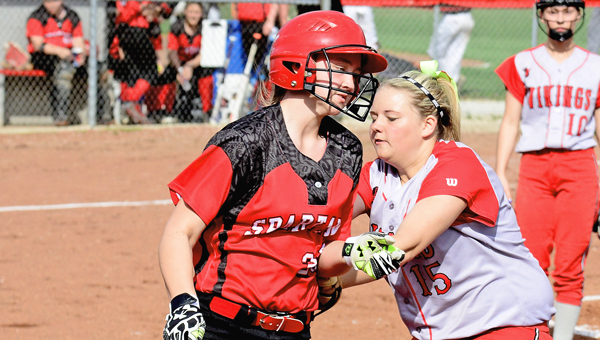 Symmes Valley Lady Vikings' first baseman Brenna Morris (15) tags out a Alexander runner in a game on Friday during the annual Valley of Thunder softball classic. (Kent Sanborn of Southern Ohio Sports Photos)