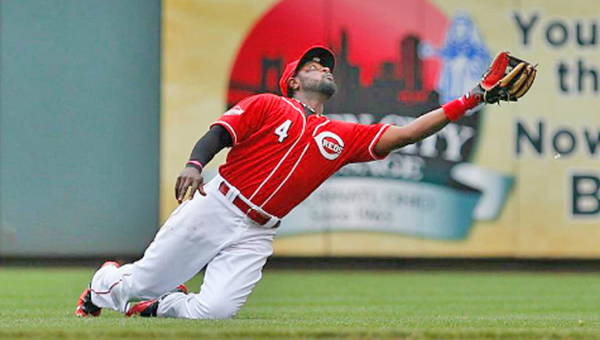 Cincinnati second baseman Brandon Phillips slips and falls during the fourth inning of Thursday's game, but he recovered and made the catch while on his knees as the Reds beat the Pittsburgh Pirates 3-2 to complete a three-game sweep. (Photo Courtesy of The Cincinnati Reds)
