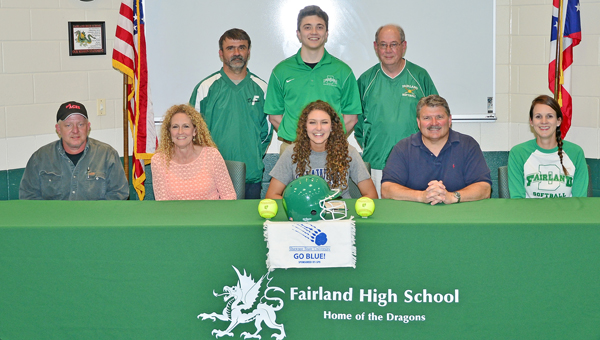 Fairland Lady Dragons' senior softball standout Mackenzie Riley signs a letter-of-intent on Friday to play for Shawnee State University. Attending the ceremony were: seated from left to right, summer travel team coach Jimmy King, mother Jo Anna Riley, Mackenzie, father Todd Riley and Fairland head coach Mindy Clark; standing from left to right, Fairland assistant coach Jason Morris, brother Eric Riley and Fairland assistant coach Jim Bailey. (Kent Sanborn of Southern Ohio Sports Photos)