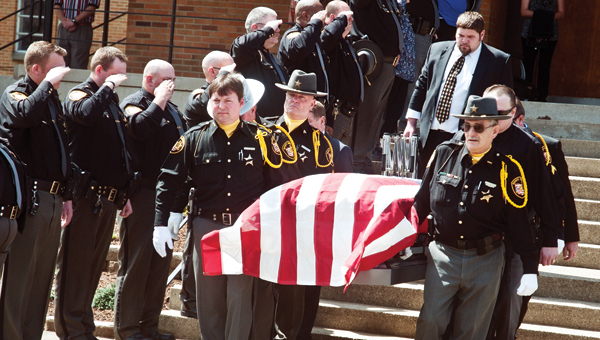 Deputies from the Lawrence County Sheriff's Office escort the casket of Deputy Sgt. Randell Rogers from the First Baptist Church on Friday.