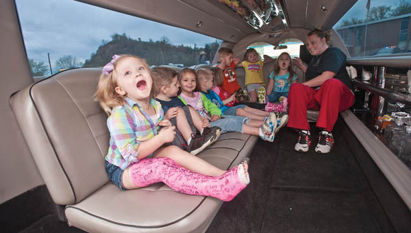 Students from the Ohio University Southern Development Center, in Hanging Rock, take a seat inside a limousine.