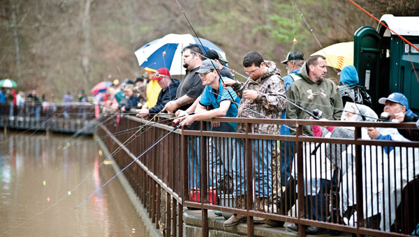 Area residents and visitors gathered on the boardwalk at Lake Vesuvius to take part in the annual Wheelin' Sportsmen Fishing event on Thursday.