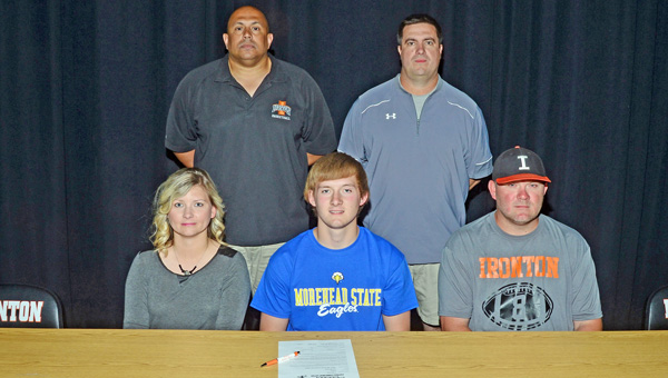 Ironton Fighting Tigers' senior quarterback and defensive back Tristan Cox signed to play football at Morehead State University. Attending the signing ceremony were: seated from left to right, mother Kelli Cox, Tristan, and father Ralph Cox; standing from left to right, Ironton athletic director and basketball coach Mark LaFon and Ironton head football coach Mark Vass. (Kent Sanborn of Southern Ohio Sports Photos)