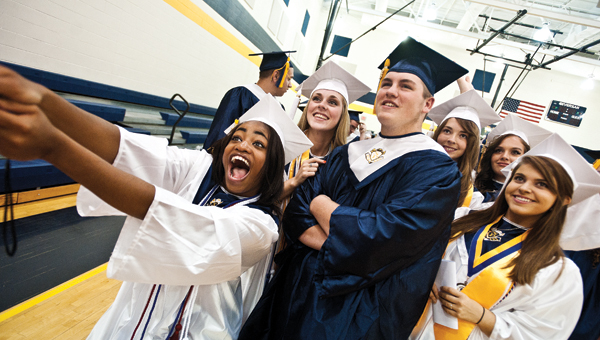 Students from the 2015 South Point High School graduating class take a selfie before the start of commencement exercises on Sunday.