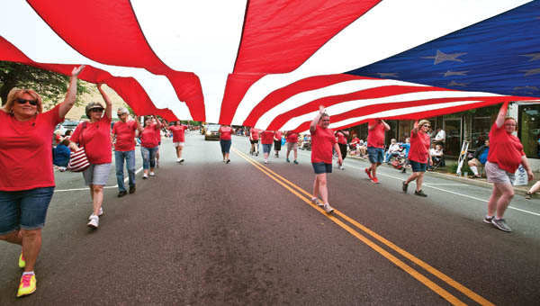 Members of Our Lady of Bellefonte Hospital carry an American flag.