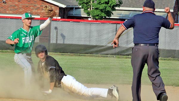 Tim Gearhart of Tim's News & Novelties, Park Ave. in Ironton Fairland Dragons' Trace Adkins (left) shows his glove with the ball to the umpire who signals that Coal Grove Hornets' baserunner Daniel Rutherford is out at second base. Coal Grove won 5-0.