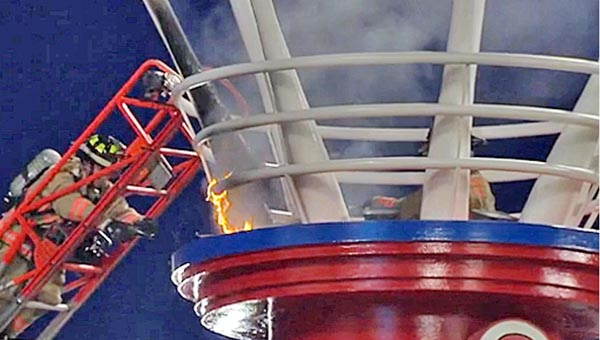 The fireworks smokestack at the Cincinnati Reds' Great American Ballpark caught fire last Friday during a game against San Francisco. The fire did not threaten the fans or stop the game. Officials said the smokestack will be ready to use when the Reds return home on Monday. (Photo Courtesy of The Cincinnati Reds)