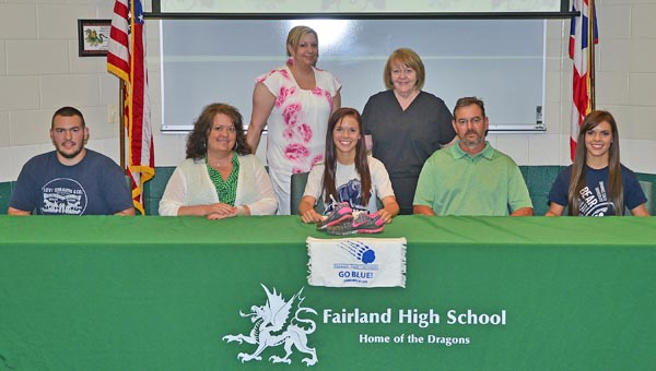 Fairland Lady Dragons' senior Emmy Fulks signed a letter-of-intent to run cross country and track at Shawnee State University. Attending the signing ceremony were: seated from left to right, brother Clay Fulks, mother Doreen Fulks, Emmy, father Frank Fulks, and twin sister Elly Fulks; standing from left to right, aunt Tara Landers and grandmother Glenda Dillon. (Kent Sanborn of Southern Ohio Sports Photos)