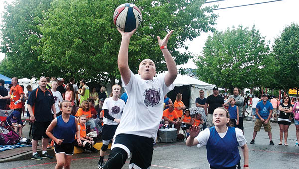 Local and visiting players take to the courts for the annual Gus Macker 3-on-3 Basketball Tournament.