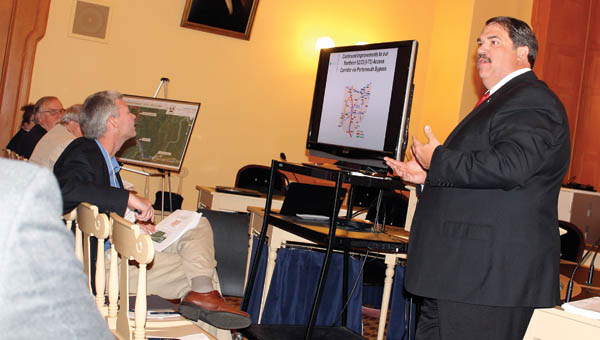 Lawrence County Engineer and co-chairman of the Lawrence County Transportation Committee, Doug Cade, goes over the updated plans and proposals regarding certain roads and intersections in the county Tuesday at the statehouse in Columbus.
