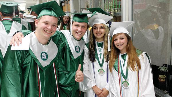 Fairland High School graduates Austin McKinney, Kayin Webb, Breahna Stirling and Jenny Mead before graduation Friday evening at Fairland High School.