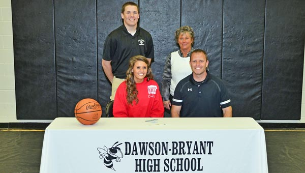Coal Grove Lady Hornets senior basketball standout Jacy Jones signed with Otterbein University on Friday. Attending the signing ceremony were: seated from left to right, Jacy and Coal Grove head ooach Rick Roach; standing from left to right, brother Jeb and mother Janet. (Kent Sanborn of Southern Ohio Sports Photos)