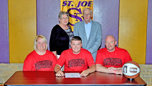 St. Joseph Flyers' senior guard Zack Kelly signed a letter-of-intent to play basketball at Muskingum University. Attending the ceremony were: seated from left to right, mother Tracy Kelly, Zack, and father Chad Kelly; standing from left to right, grandparents Kay and Tom Kelly. (Kent Sanborn of Southern Ohio Sports Photos)