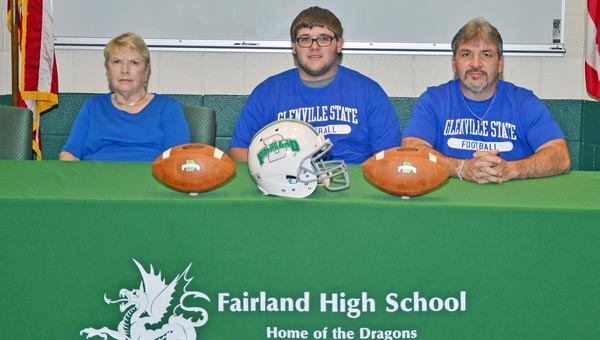 Fairland Dragons' senior lineman Zach McKinney signed a letter-of-intent with Glenville State on Tuesday. Attending the ceremony were, from left to right, grandmother Brenda McKinney, Zach, and father J.C. McKinney. (Kent Sanborn of Southern Ohio Sports Photos)