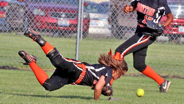 Ironton Lady FIghting Tigers' outfielder Taylor Monk dives for the ball while Zjaytia Black-Mize provides backup during Friday's Division III sectional tournament game. Minford held off Ironton to win 11-9. (Tim Gearhart of Tim's News & Novelties, Park Ave. in Ironton)