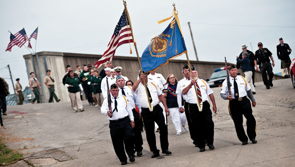 American Legion Post 433 leads participants down to the Center Street Boat Landing, in Ironton during the annual Navy Night Memorial Service event Thursday.