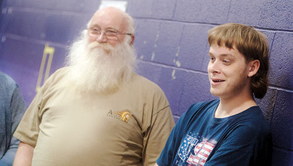 Gregory Caldwell with his grandfather during his graduation reception at Open Door School Tuesday.