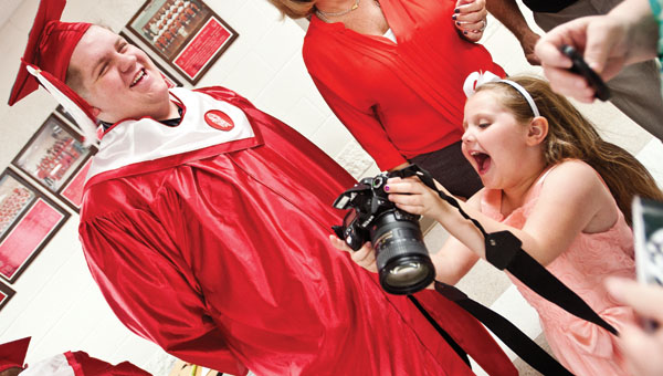 Allie Bridges shows her uncle, Bradley Blankenship, photos she snapped of him.
