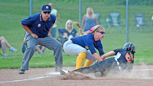 South Point Lady Pointers' shortstop Haley Rawlins (left) tags out a Portsmouth West runner sliding into third base during Thursday's Division III regional semifinal game. South Point lost 2-0. (Kent Sanborn of Southern Ohio Sports Photos.com)
