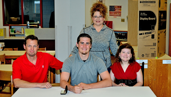 Coal Grove Hornets' senior quarterback Jesse Rigsby signed a letter-of-intent with Denison University on Wednesday. Attending the ceremony are: seated from left to right, father Jere Rigsby, Jesse, and sister Jeri Leigh Rigsby; standing is his mother Rachael Rigsby. (Kent Sanborn of Southern Ohio Sports Photos)