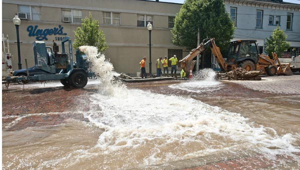 Three separate pumps work full time as crews with the City of Ironton work to fix a water main break Wednesday on Vernon Street.