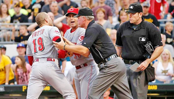 Cincinnati's Joey Votto (19) is restrained by third base umpire Ted Barrett and Reds' manager Bryan Price while arguing with home plate umpire Chris Conroy after being ejected in the third inning of Wednesday's game. (Courtesy of The Cincinnati Reds.com)