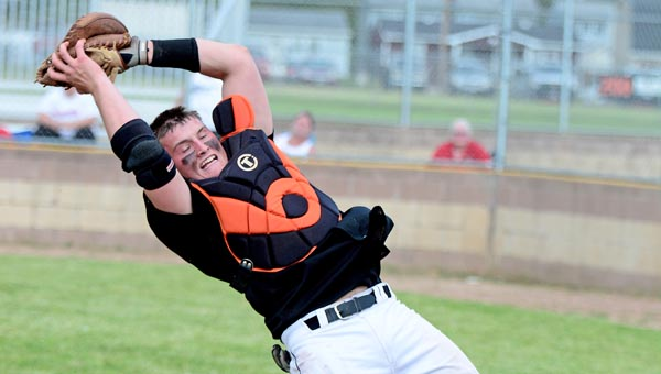 Ironton Fighting Tigers' catcher Hunter Weber makes a nice catch of a foul pop up during Tuesday's Ohio Valley Conference game against Rock Hill on senior night for Ironton. (Kent Sanborn of Southern Ohio Sports Photos)