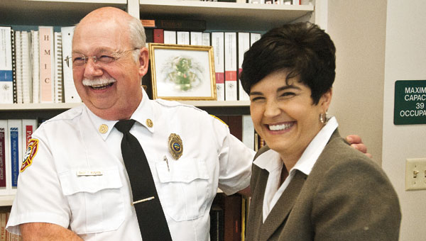 Chief Tom Runyon, of the Ironton Fire Department, with Katrina Keith during his retirement party celebration Tuesday. Runyon has served with Ironton for over 28 years.