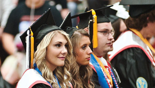 Graduating students take in the last bits of advice from their peers during commencement on Sunday at Dawson-Bryant High School.